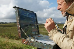 Artist Shaun Carey painting in Blakeney at Paint Out Wells 2017. Photo by Katy Jon Went
