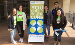 Student volunteers table outside the Business Building.