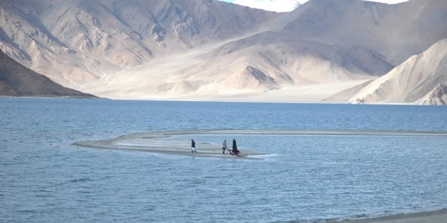 Pangong Lake, is an endorheic lake in the Himalayas situated at a height of about 4,350 m (14,270 ft). It is 134 km (83 mi) long and extends from India to Tibet. Approximately 60% of the length of the lake lies in Tibet. The lake is 5 km (3.1 mi) wide at its broadest point. All together it covers 604 km2. During winter the lake freezes completely, despite being saline water. It is not part of Indus river basin area and geographically a separate land locked river basin.[3] The lake is in the process of being identified under the Ramsar Convention as a wetland of international importance. This will be the first trans-boundary wetland in South Asia under the convention.