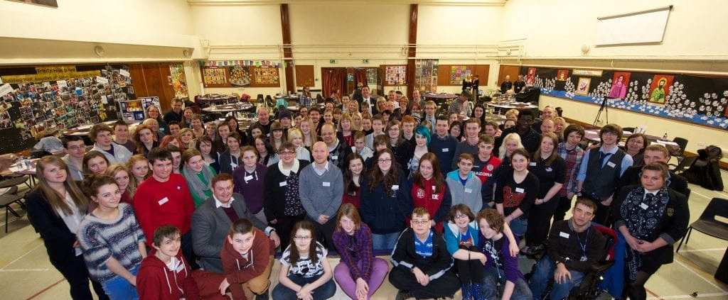 Community Planning Conference for young people working at tables
