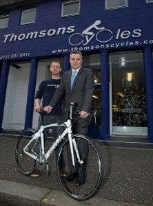 Martin Johnston, manager at Thomson Cycles in Causeyside Street, Paisley is gearing up for busy times ahead after the business got a helping hand with a whopping £10,000 improvement grant from Renfrewshire Council to give the entrance to the shop a makeover. He is pictured with council leader Mark Macmillan who called in to see the changes.