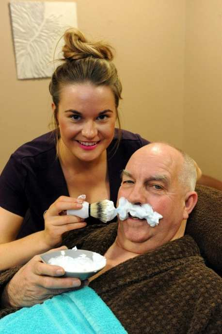 Emma Macdonald of EVE Spa gets ready to shave Depute Provost John Caldwell