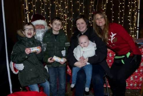 Johua Joseph and mum Lyndsay Kyle with baby ella visit santa and his helper