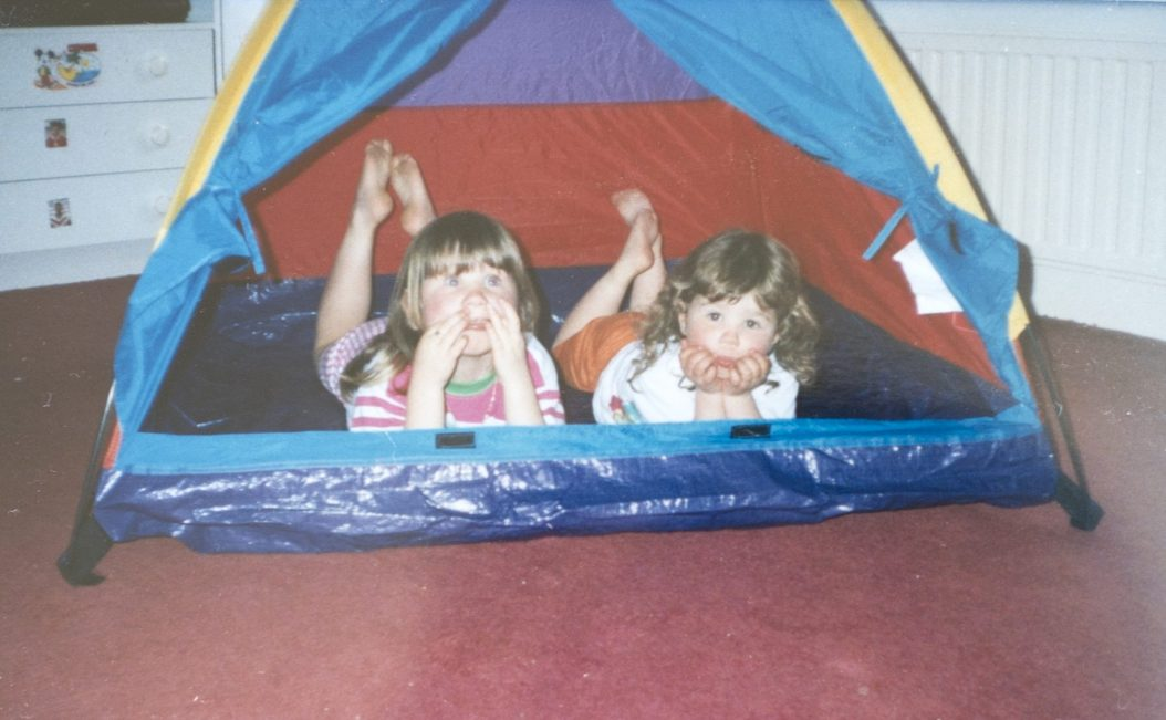 Stephanie Cassells (left) with sister Gemma Cassells (right) in tent as kids