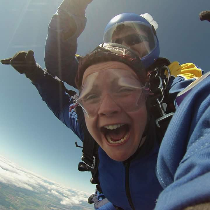 Breast cancer survivor Claire Ann McCallum skydiving in New Zealand