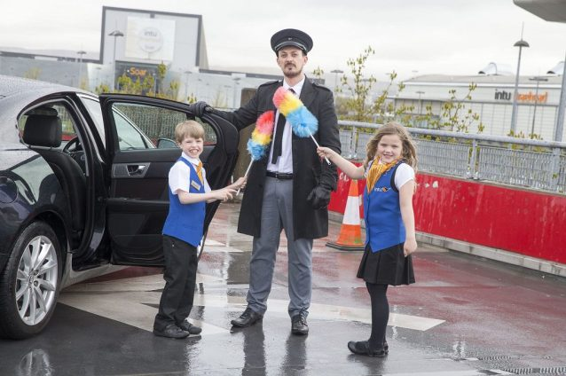 A tickling stick always comes in handy for the new intu Braehead Heads of Fun, Aidan Smith and Lucie Roy when they arrive at their new job in a chauffeur-driven car.