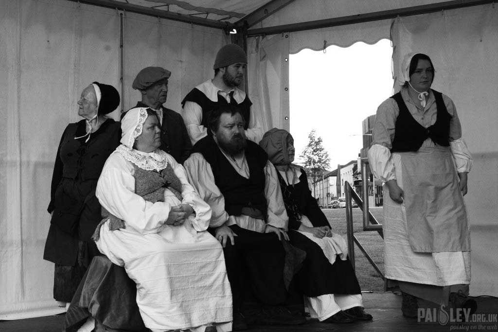 local people in period costume to re-enact the day