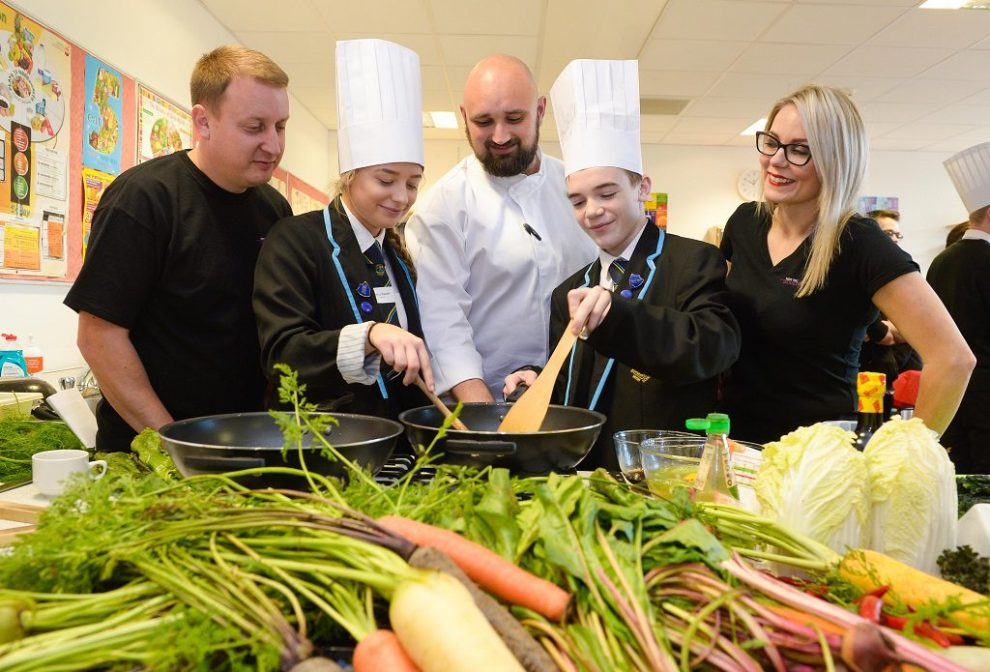Pupils Alesha Baxter and Cameron Johnston cooking up a storm with Kained Holdings' Group Development Chef Scott Leask, alongside Stephanie Wade, Director of the Tennent's Training Academy, and Dougie Clark, Director of Tree of Knowlede
