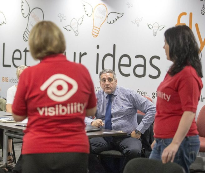 Shopping centre boss Peter Beagley listens intently to Visibility trainers during a briefing session