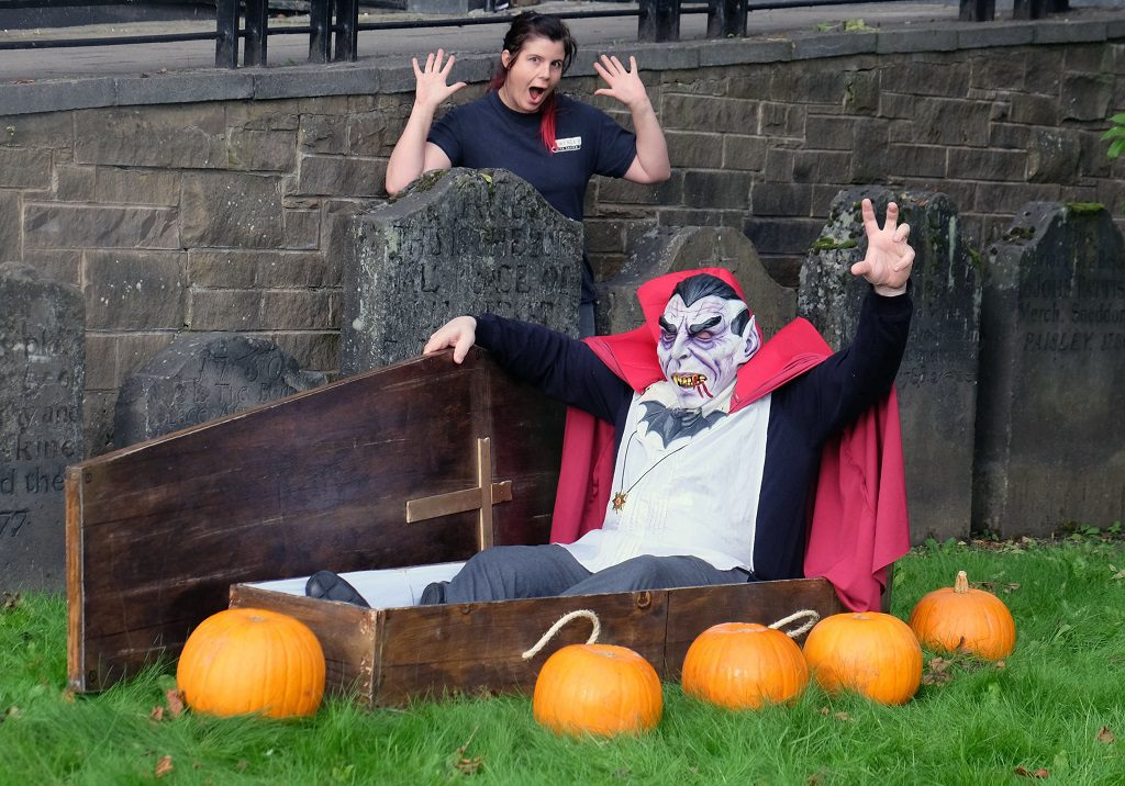 Graveyard tour guide Emma Armstrong gets a fright as she stumbles on Dracula and his coffin in the ground of Paisley Arts Centre