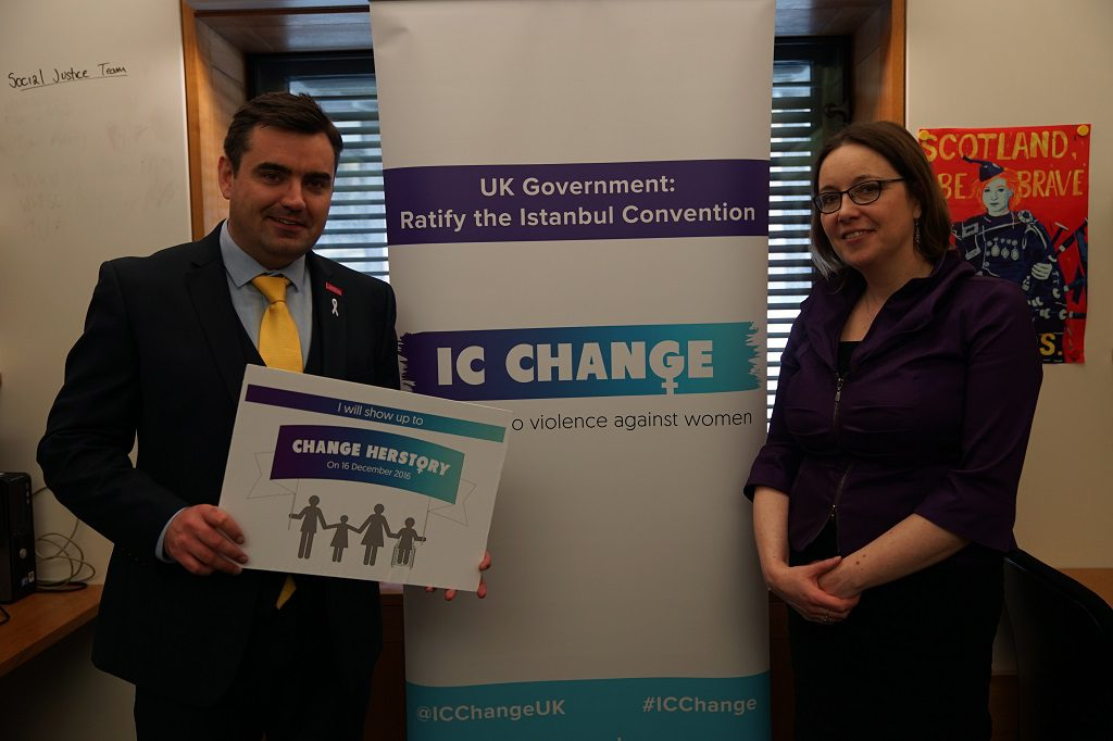 Gavin Newlands MP and Eilidh Whiteford MP hold a sign to show support for the IC Change Campaign to end violence against women
