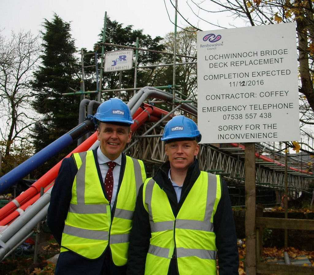 Irish Minister for the Diaspora and International Development, Joe McHugh TD (left) take a look at the Coffey Construction bridge project at Lochwinnoch with company Managing Director,  Odran Madden.