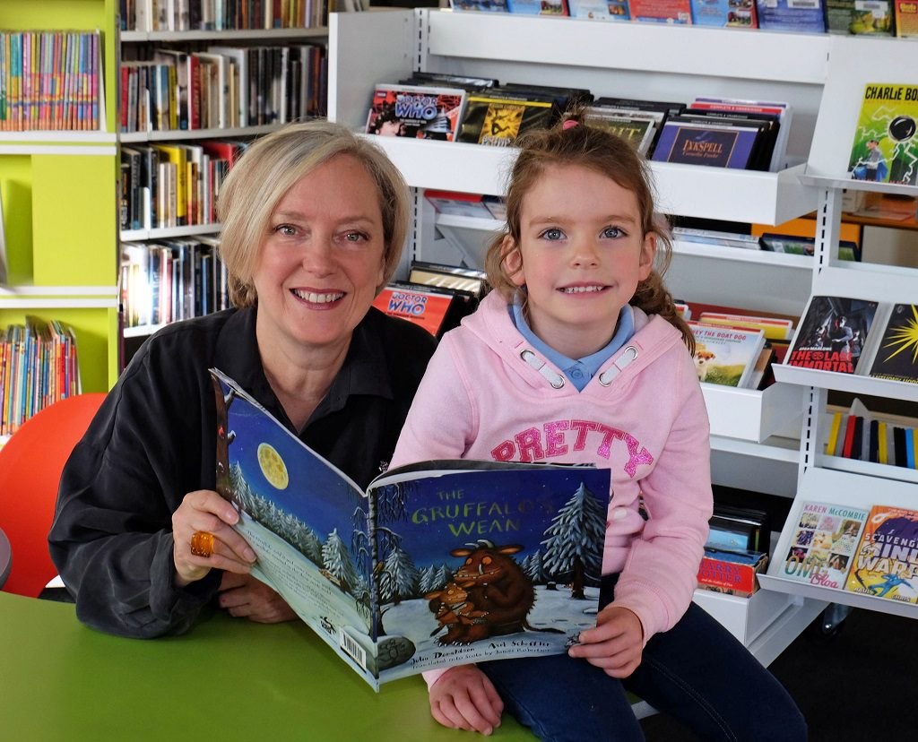 Janice Forsyth and four-year-old Millie Fox before the live radio show was broadcast from Johnstone Library.