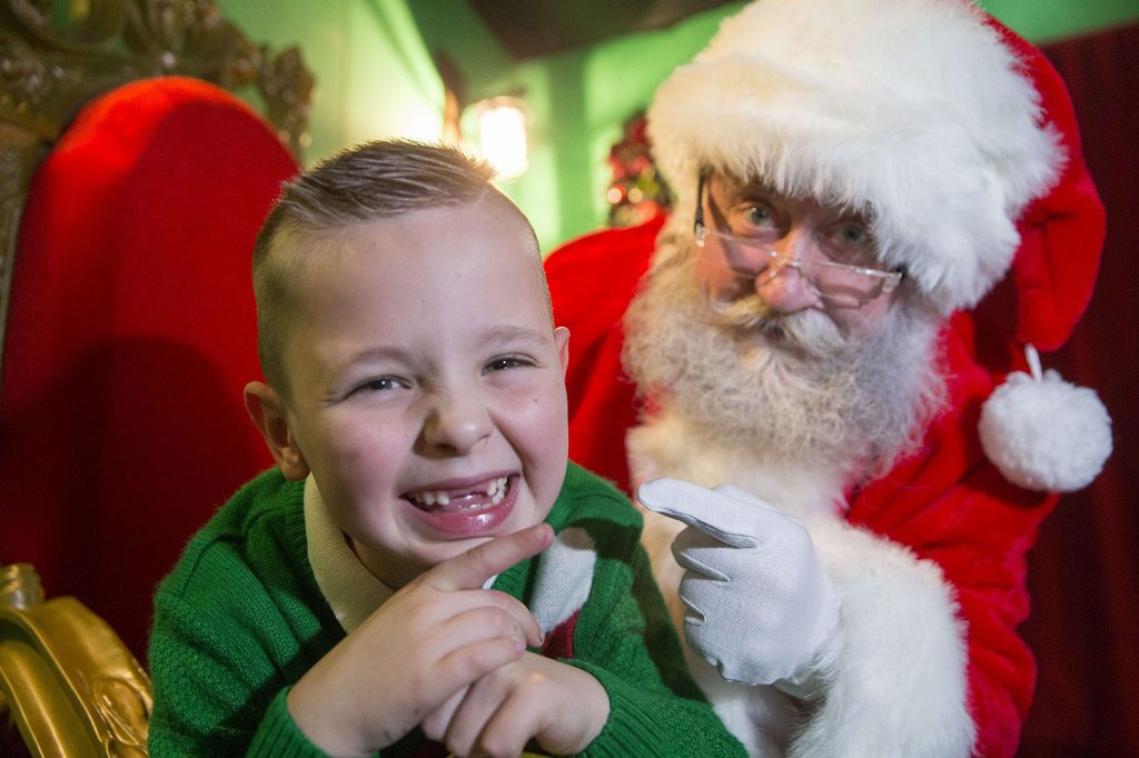 Owen Macdonald, aged seven showing Santa at intu Braehead why he wants two front teeth for Christmas