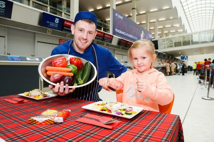 Picture - Nick Ponty Glasgow Airport is the first Scottish airport to receive VisitScotlandÕs ÔTaste our BestÕ accreditation. l-r Chef Alex Sivewright with passenger Emily Morgan (5)