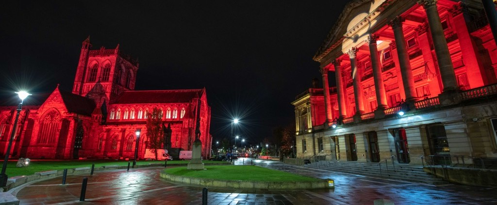 Paisley Abbey and Paisley Town Hall lit up in red