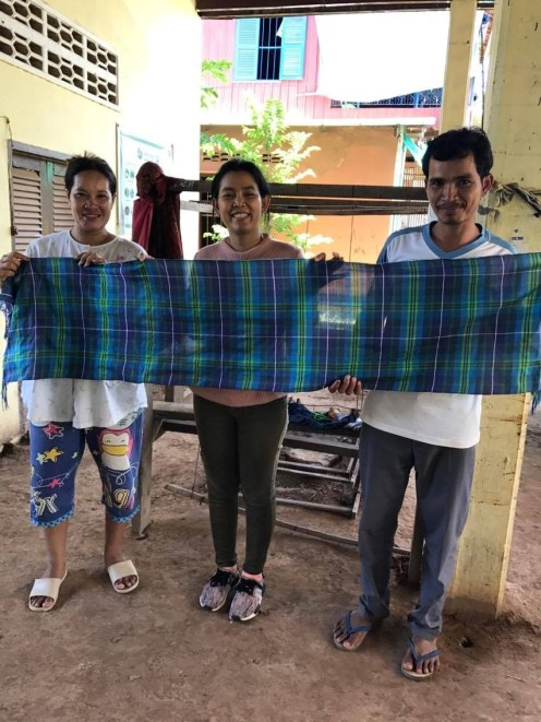 Anak with weavers in Cambodia