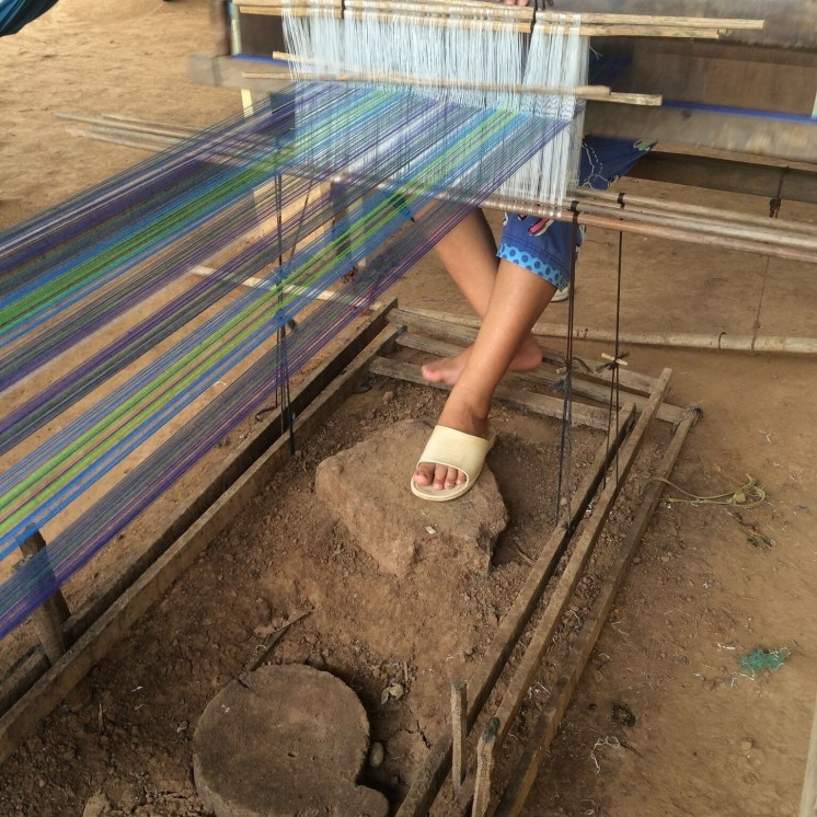 Artisan in Cambodia weaving the fair trade tartan