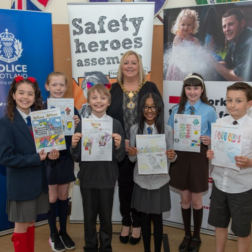 Renfrewshire's Provost Lorraine Cameron with Safe Kids poster winners