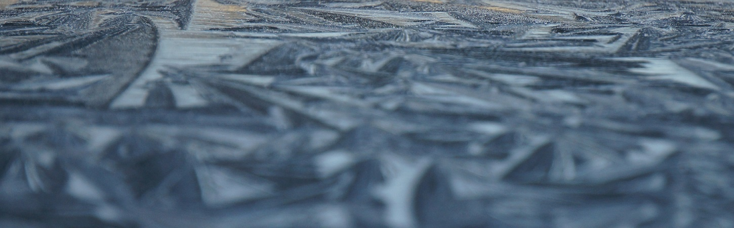Close-up Ice Pattern on a Black Car Roof