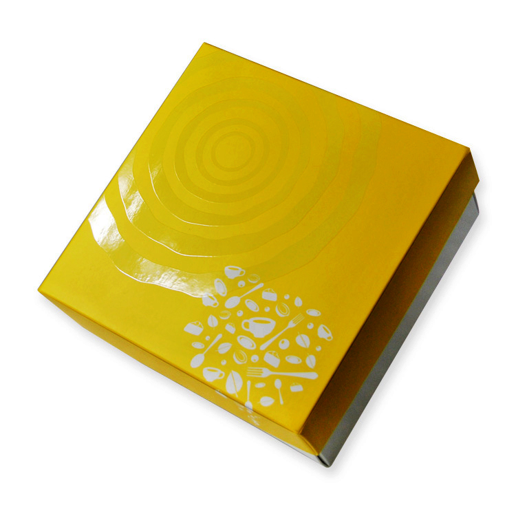 A yellow custom box design with spot UV application.