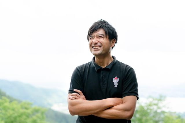 「爽やかな笑顔のゴルファー」のフリー写真素材