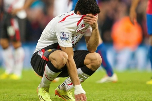 Cheating cry-baby Suarez hides his tears. He'll be even sadder now.