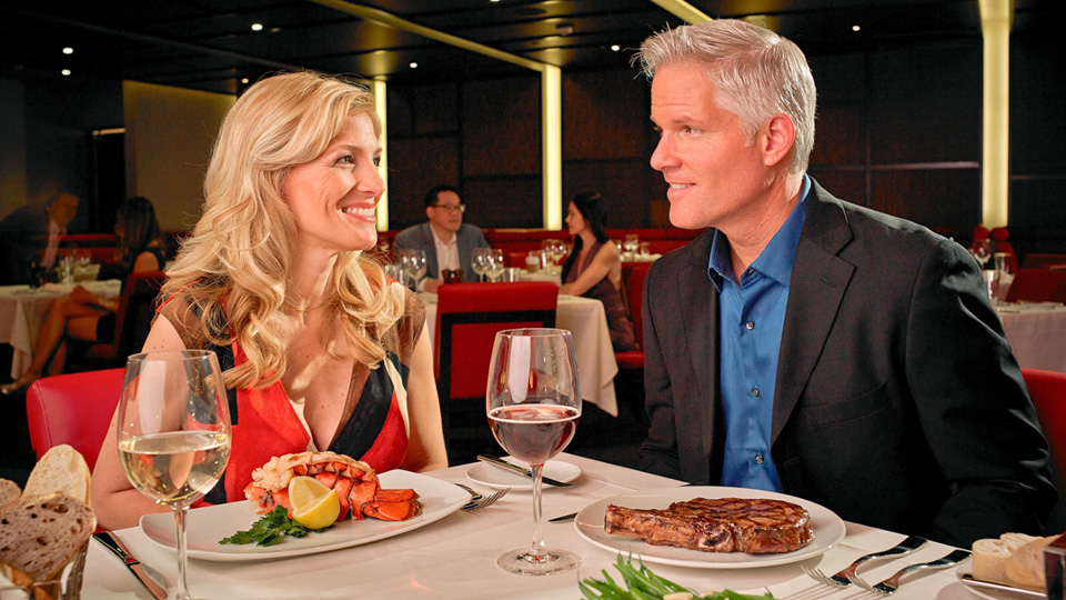 couple dining together with food and wine