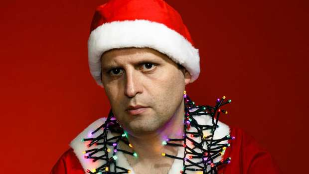 Adam Kay wearing Christmas Lights and Santa Hat in Twas the Nightshift Before Christmas