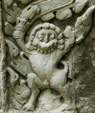 Temple pillar showing odd carving at base