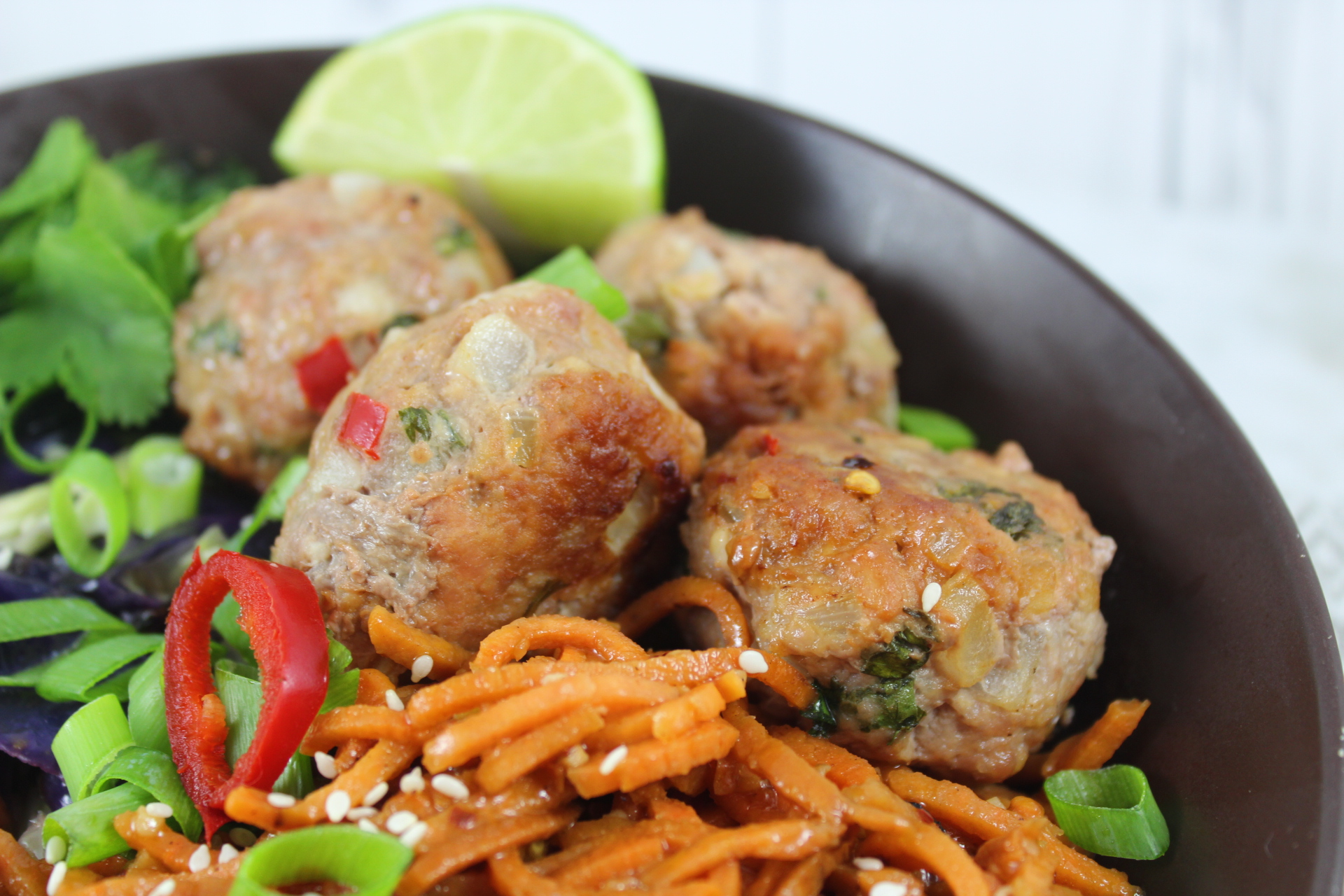 paleo spicy pork meatballs and sesame noodles