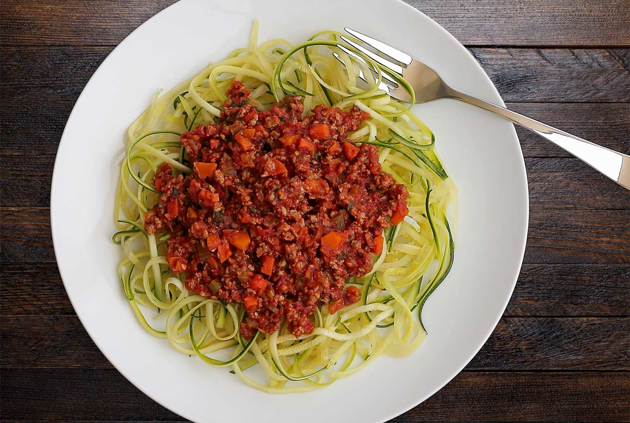 paleo spaghetti with zucchini noodles and bolognese sauce from paleonewbie.com