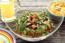 Easy paleo recipe for Mexican Layered Dip with Plantain Chips