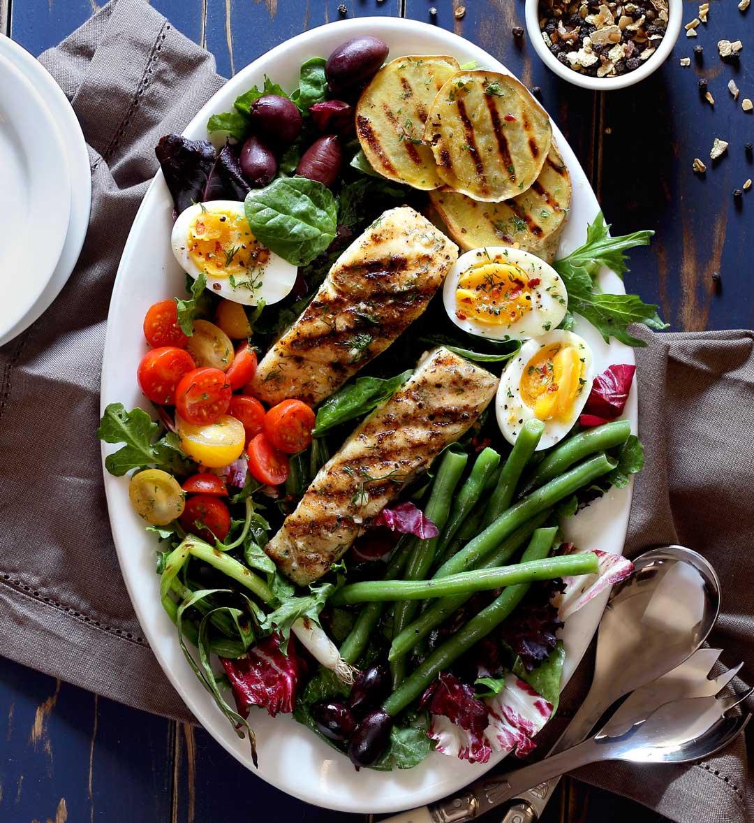 simple recipe for halibut nicoise salad with a lemon and herb vinaigrette