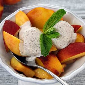 easy paleo recipe for a cream fruit topping made from coconut milk and spices
