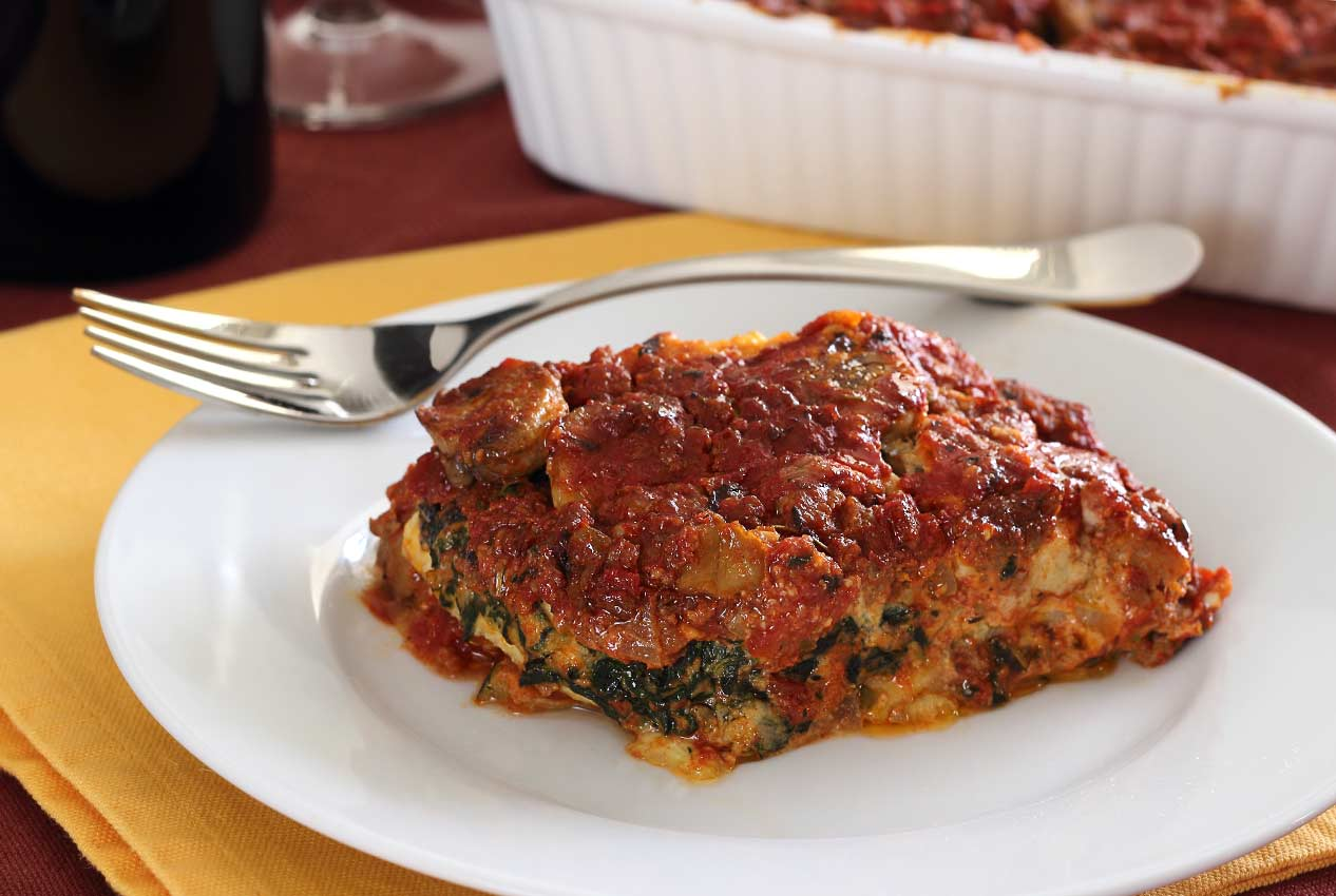 paleo, gluten-free, and dairy-free plate of lasagna with a hearty Italian meat sauce, zucchini noodles, and a unique nut cheese