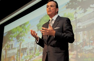 Rick Caruso speaking to a packed Mercer and Gilbert Halls at Palisades High School in 2014.