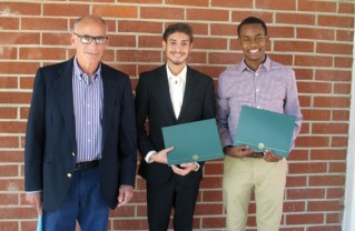 Optimist Dan Ackerman presented scholarships to Ethan Acevedo and Biniyam Asnake (right).