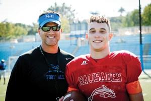 Coach Tim Hyde talks with starting quarterback Gabe Galef.