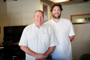 Gary Beckwith and his son, John, at Beckwith Insurance. Photo: Lesly Hall