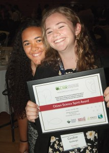 Makayla Michelini and Caroline Bamberger showing off the Citizen Science Spirit Award.