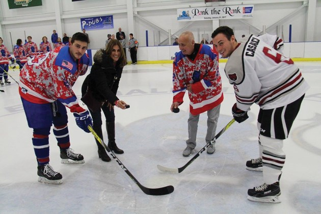 Palisadian Dana Rivera, a stroke survivor and Danny Kubear, a 5-time stroke survivor from Fredo, New York, dropped the puck to start the match.