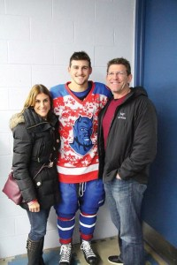 Dana and Rick Rivera with son Luke, who plays for the Fredonia Blue Devils.