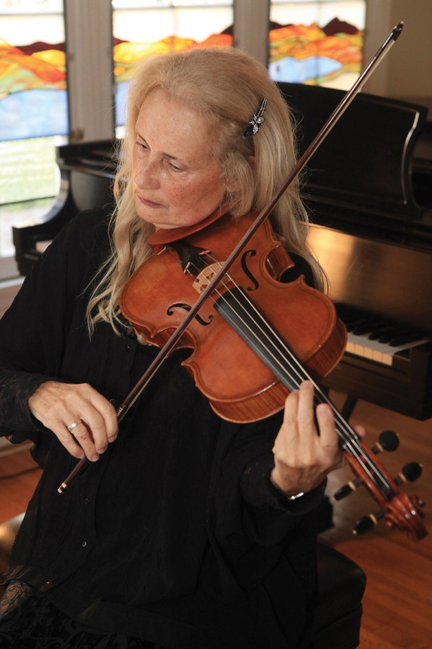 Rebecca Rodman has mastered the art of violin making. Photo: Bart Bartholomew