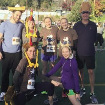 (Left to right) Henry and Katie Moray, Jennie, Molly and Greg Porter, (front row) Jane (left) and Macaulay Porter ran in the Turkey Trot, wearing festive hats.