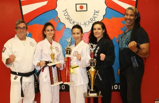 (Left to right) Marc Lamaze, Skylar Saltzman, Michelle Villemaire, Tamar Springer and TJ Storm pose with trophies won by Saltzman and Villemaire.