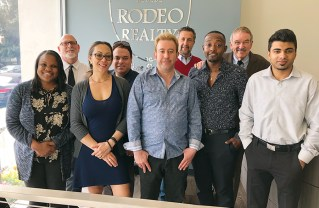 The Chamber's Arnie Wishnick joins Rodeo Realty agents and staff (left to right) Stephanie Daniels, Larry Warren, Kat Johnson, Nick Spirtos, Alex Gharibian, Marty Halfon, Ryan Victor, Wishnick and Puvnit Ransi.