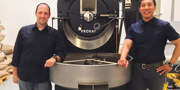 Caffe Luxxe owners Mark Wain and Gary Chau work with their coffee roasting.