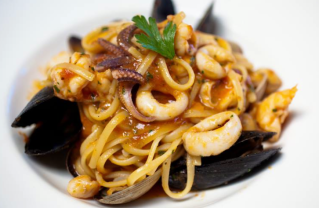 """My Linguine ai Frutti di Mare was equally special and delicious. The linguini pasta with its zesty tomato sauce is served with fresh clams, mussels, calamari and shrimp."" Photo: Divino (Facbeook)."