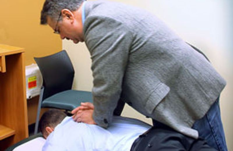 Men on a chiropractic